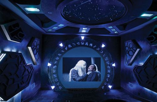 Stargate Atlantis themed home theater room developed by Jacob Yarmuth. It boasts a couple of Sony megachangers that can attach 800 DVDs, a 10 foot diagonal circuit screen (that shows a 96 inch diagonal image), Atlantic's THX series speakers, a couple of Polk Audio IW155 in-wall subwoofers and a JVC RS-1 D-ILA light amplifier for HD imagery.
