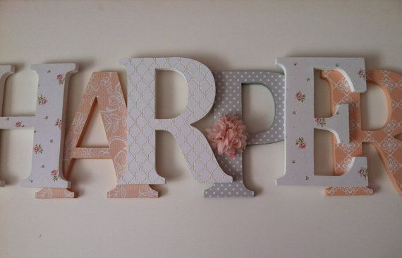 Spell out your childs name with these adorable peach, gray and white wooden letters These letters will look great sitting on a shelf or a bookcase