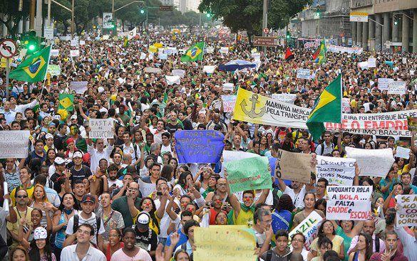 Demonstrators hoild a protest in Rio de Janeiro - courtesy Semilla Luz