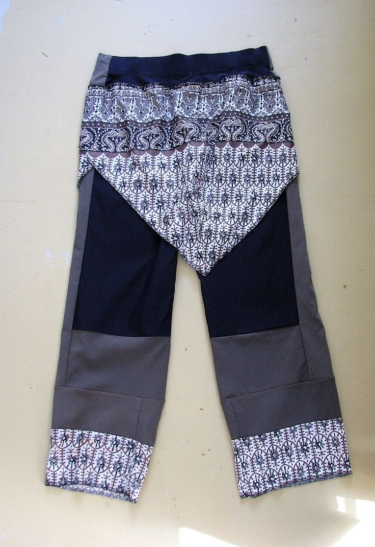 Trousers remade using a dress and pairs of elastic waisted trousers.