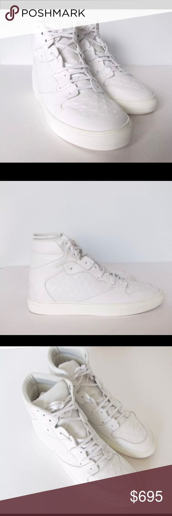 NWTS Balenciaga White Sneakers NEW/UNWORN Balenciaga White Leather Sport dipping Hi-top Sneakers. Nobody fuses sportswear and luxury more successfully than Balenciaga, as these eye-catching sneakers truly demonstrate. They've been constructed in Italy from smooth white leather with rubberized trims for a slick finish.                    .   **RETAILS FOR $775 +TAX** Balenciaga Shoes Sneakers