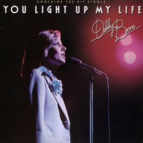 You Light Up My Life, by Debby Boone.  The greatest and most God Awful one hit wonder of all time.  It seems like this was somewhere on the radio every minute of every day from 1977 until 1980.