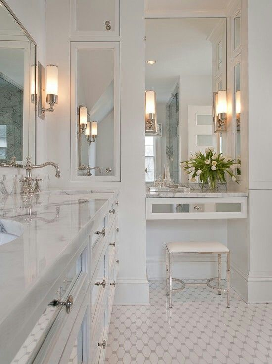classic white bathroom with lovely tile pattern... cool bench!