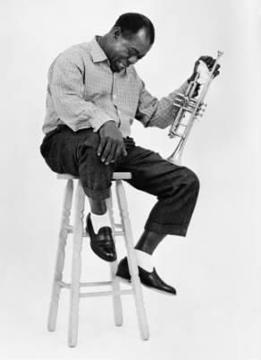"""LOUIS ARMSTRONG (born Louis Daniel Armstrong on August 4, 1901 in Louisanna, USA. He died on July 6, 1971).  Nicknamed Satchmo or Pops.  An """"inventive"""" cornet and trumpet player and singer."""
