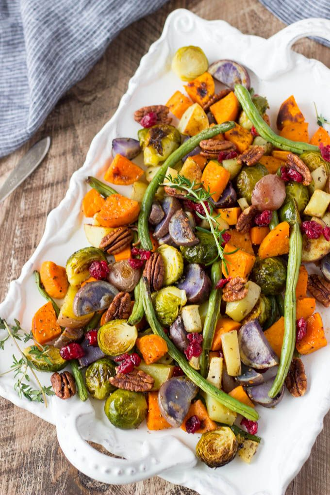 A super easy holiday side dish that can be made up to a day in advance and requires only one pan. Thanksgiving favorites like sweet potatoes, green beans, Brussels sprouts and potatoes, topped with candied pecans and dried cranberries.