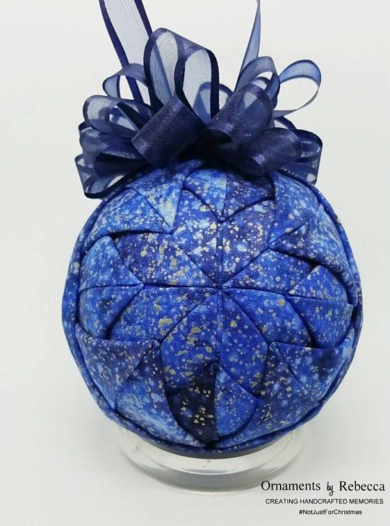 One of a kind Quilted Fabric Christmas Keepsake Ornament The Gift! We three kings of Orient are; Bearing gifts we traverse afar. Beautifully done, this ornament features the three kings as they arrive offering their gifts for Baby Jesus which were Gold, Frankincense and Myrrh. Measures approximately 3 in diameter and features a classic blue bow on top. Makes a great secret Santa gift or a perfect decoration to be used on a tree, a stand or on a wreath. Ornament contains straight pins and is…