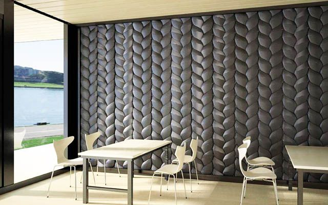 "The ""Universal wall panel"" by Natalia Strekalovskaya is made from solid black Corian sections to create a pattern to that of a braid"