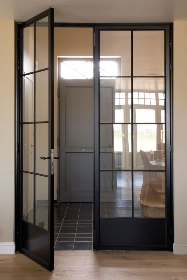 Simple hallway. Steel doors to divide foyer that give a modern feel