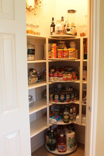 Lazy Susan's installed in pantry - decor chick.  Her dad made these but there are sources online to buy the brackets - probably cheaper to buy vintage wood lazy susans from thrift stores and mount in your cabinets.