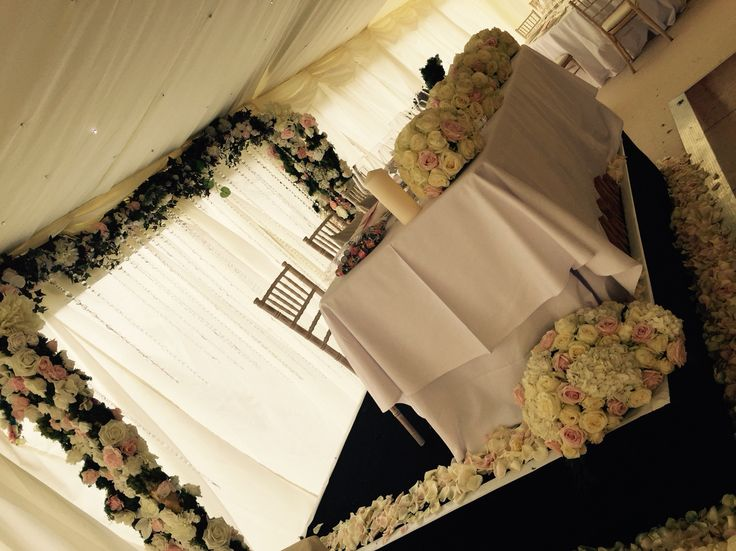 Top table with floral arches