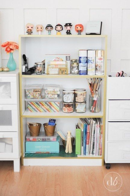 Stick washi tape to your bookcase for effortless gold edging: