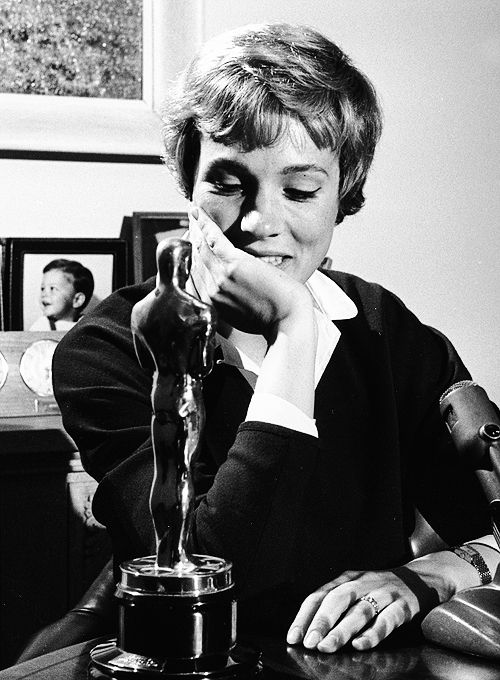 Julie Andrews admires her Academy Award she won for 'Mary Poppins', 1964.  // (via maryhartleys)