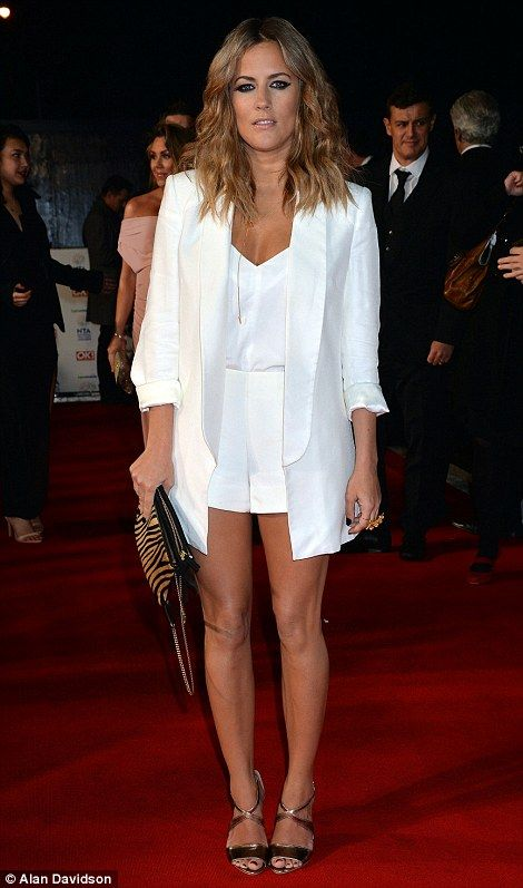 Standing out: Caroline Flack wore a glossy white ensemble for her night on the red carpet - NTA Awards