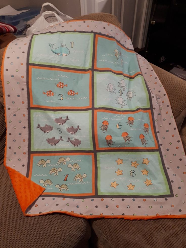 Cute little ocean themed baby blanket. Sewn by this baker sews