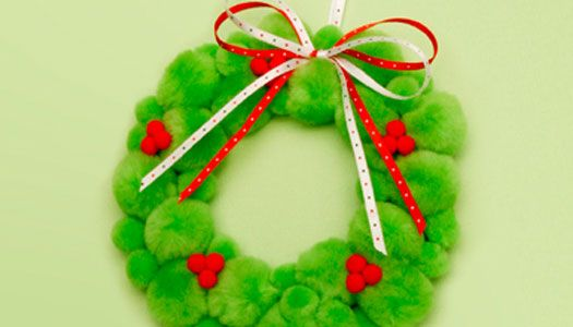 Your kids can use card stock, pom-poms and ribbon to make this cute wreath, a lovely Christmas decoration for any room!