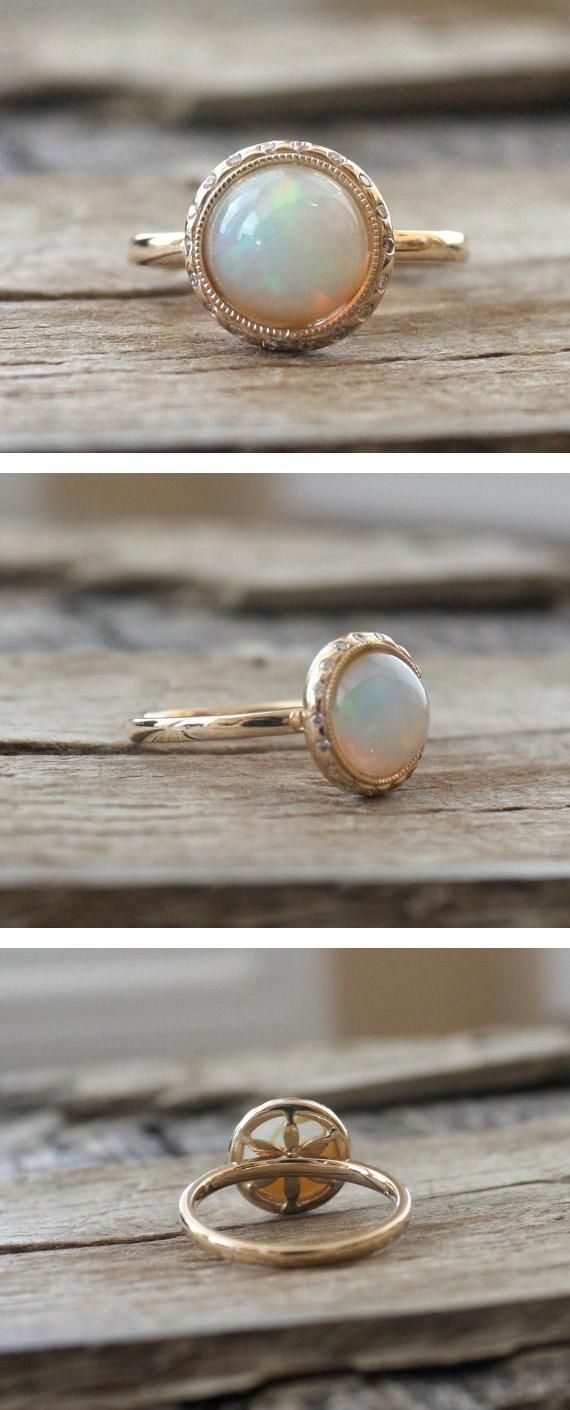 A twinkling band of burnish-set, brilliant-cut diamonds encircles — but doesn't outshine — the fiery white Australian opal at the center of this unconventional engagement ring. #etsyweddings