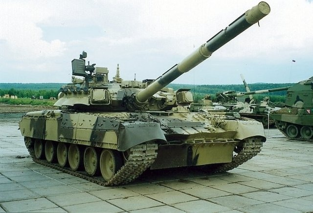 "Many consider the T-80 Main Battle Tank to be no more than a variant of the T-72. Some even consider the ""T-72"" to be an export version and the T-80 to be the true T-72 MBT used by the Soviet military.  The T-80 is a faster, more heavily armored tank than the T-72. The T-80 is powered by a gasoline turbine engine that gives the tank a ground speed in excess of 40 miles per hour. The tank is equipped with the Kobra missile system and can fire an antitank missile through its 125mm smoothbore…"