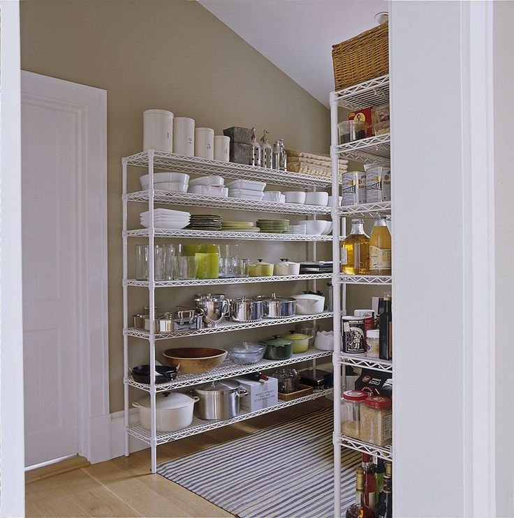 In the pantry, simple wire Metro shelving holds plates, props, and supplies.  - GoodHousekeeping.com