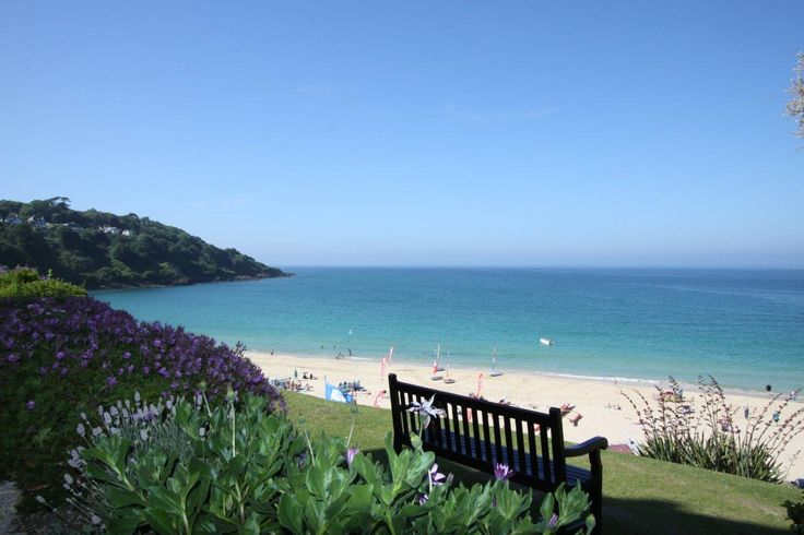 Would you like to be sitting on this bench?  One of the best views in Cornwall...but then we are a little biased!  It's Carbis Bay in St Ives taken in September as the Summer holidays draw to a close.
