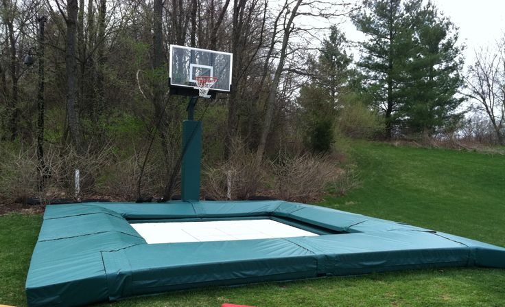 14'x14' Super Quad trampoline, outdoor installation complete with pads and even a basketball hoop for sick slam ball games! maxairtrampolines.com