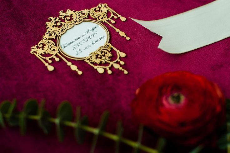 Red velvet wedding album with golden decor.