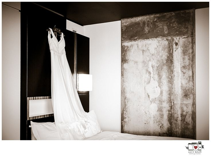 exposed cement wall makes a really cool statement and is an interesting juxtapose to the softness of the dress