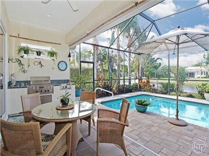377 Mallory Ct, Naples, FL 34110 — This magnificent home has a first class location West of US 41 only minutes from Barefoot and Vanderbilt Beaches. The community, Eden on the Bay, is truly a hidden gem with low HOA fees. The house is an extended Hibiscus floor plan with western exposure overlooking a beautiful lake with a fountain. Built in 2003, it has a newly painted exterior and shows like new, in- and outside! This 3+Den home features 10 feet ceilings with trays and crown moldings…