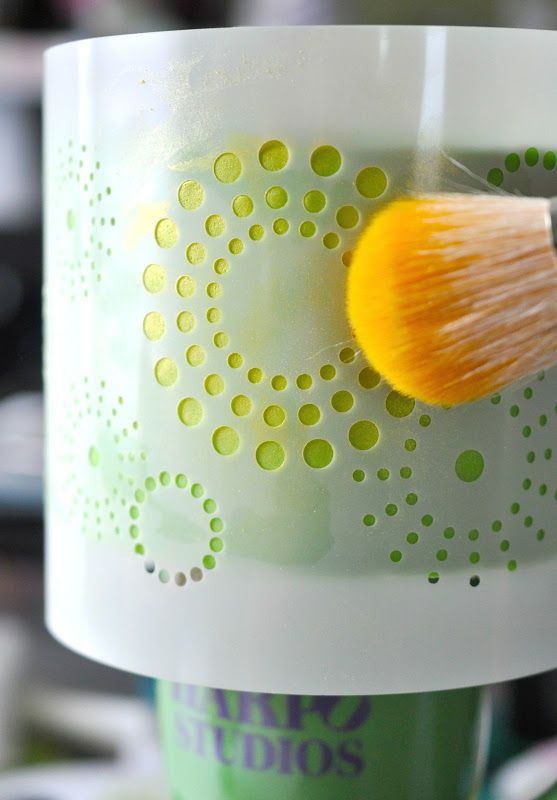Stenciling a cake using lustre dust. So pretty.