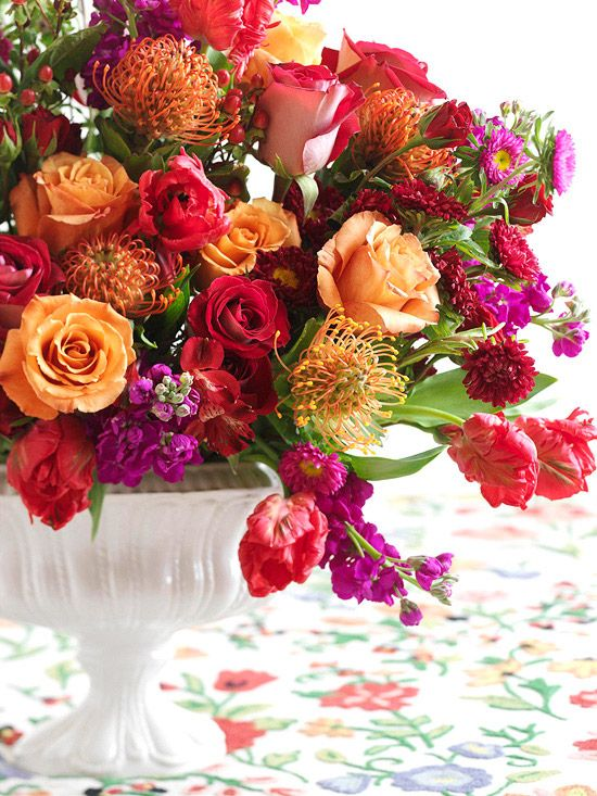 Combine roses, tiger lilies, and other flowers for an eye-catching centerpiece: http://www.bhg.com/wedding/centerpieces/beautiful-wedding-centerpiece-ideas/?socsrc=bhgpin102814traditionalweddingmixofblooms&page=1