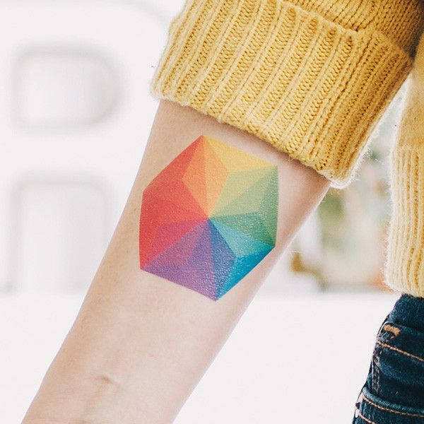 Color wheel tattoo arm graphic