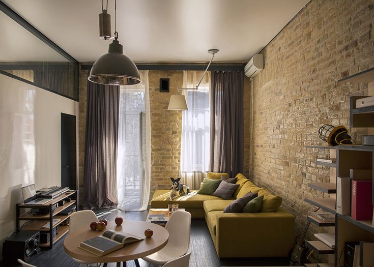 Loft-appartement met bakstenen muur. Bekijk het project op: http://www.interieurdesigner.be/blog/detail/loft-appartement-met-opvallend-volume-in-osb-platen
