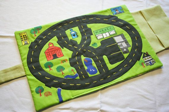 On the go Car Mat - this has a nice little pocket for three matchbox cars. Adapt the idea for my town page, but make like a parking lot, with black fabric separated by yellow ribbon lines.
