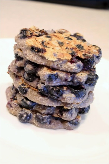 Ingredients 1 c. old-fashioned rolled oats 1/2 c. cottage cheese 2 large eggs 1 t. vanilla extract 1 c. blueberries (frish or frozen, thawed)  Directions In a blender or food processor, combine oats, cottage cheese, eggs, and vanilla.  Blend or pulse until smooth.  Gently stir in thawed blueberries.  Coat skillet or griddle with cooking spray, and spoon about 3 tablespoons of batter per pancake onto your cooking surface.  Cook about 5 minutes per side, or until tops are covered with…