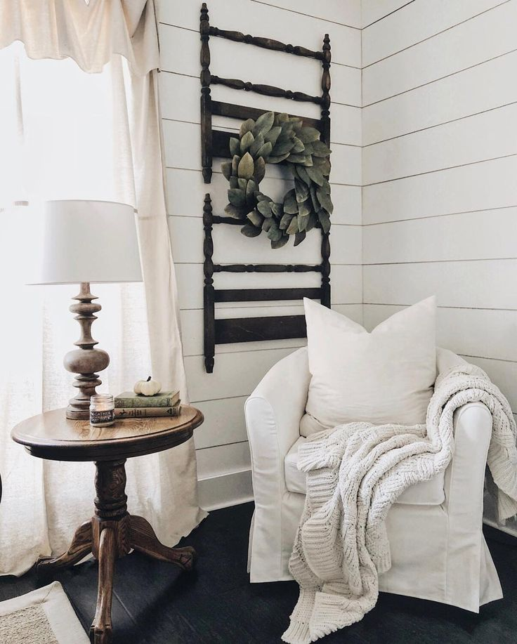 An old ladder repurposed into a living room decoration / feature