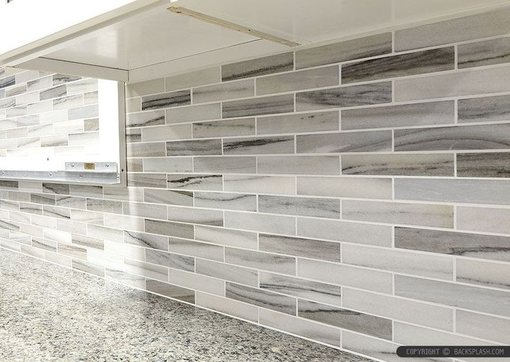 Gray white some brown tones modern subway kitchen backsplash tile from Backsplash.com