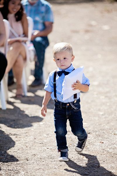 Casual wedding outfit idea for a ring bearer - jeans and suspenders with a bowtie - ADORABLE! {Nicolette Moku Photography}
