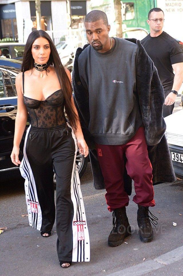 Kanye West wearing Adidas Yeezy Season 4 Calabasas Sweatpants, Vintage  Champion Script Hoodie, Yeezy