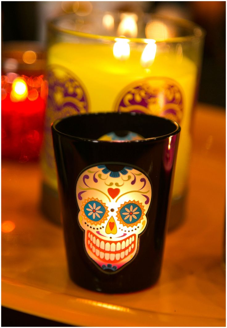 Dance magic dance! Decorate with a duo of these Day of the Dead-inspired Skeleton Dance Votive Pair om PartyLite.