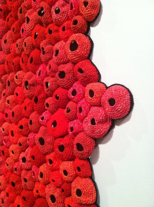 "Barletta's ""Pelt"" (seen in this detail) resembles microscopic cells writ large. The process of crochet, which uses small units to build a larger whole, mimics the growth of biological organisms. (Michael O'Sullivan)"