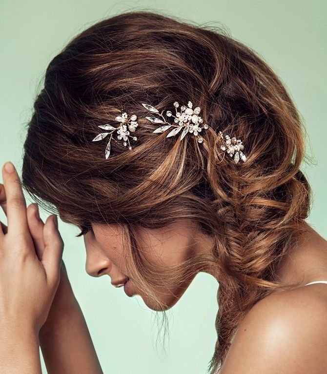 Dress up any hair style with a spray of just the right amount of sparkle. Clear crystals sprout from a blossom of fresh water pearl, crystal and glass bead flowers in this set of three pins. Made with pin-able loops for flawless styling.