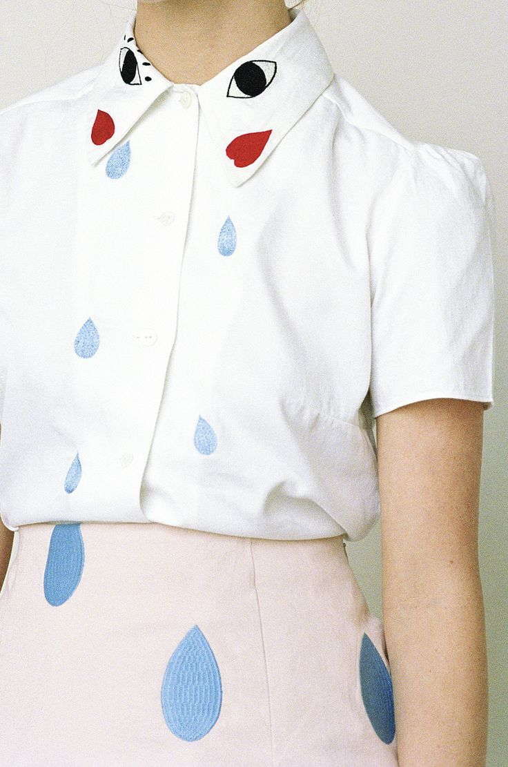 White cotton blouse with hand-embroidered faces and tear drops. 100% Cotton Made in India