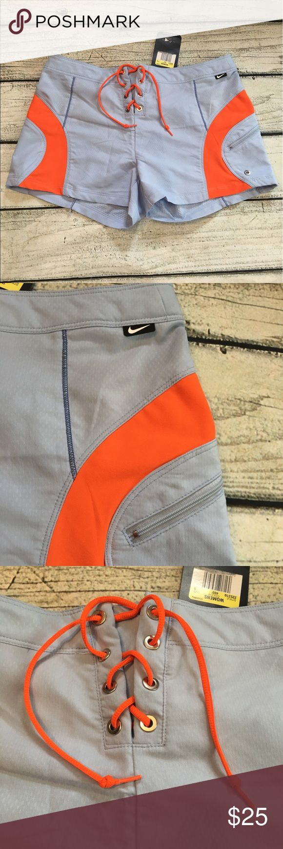 NWT Nike sphere dry light blue orange shorts S NWT Nike sphere dry woman's light blue and orange board shorts lace up string front has side zipper pocket size small see measurements in pictures. Nike Shorts
