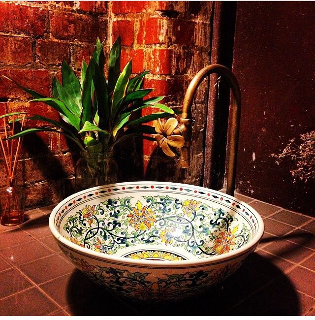 Hand painted bowl as sink in bathroom