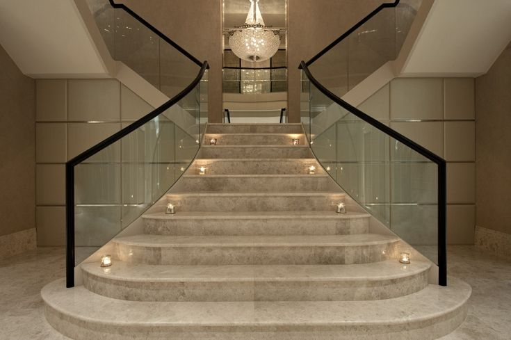 Two specially designed coat cupboards beneath the grand staircase in the entrance hall - Home entrance stairs design ...