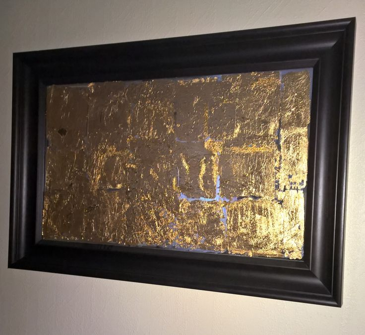 "Some wall art my sister and I made for her living room a few years ago  Super simple and gives the room a nice warm glow  It's made from a simple Ikea mirror (frame included) that we just glued some ""gold-leaf"" onto. Quite proud of this one  And here's a tiny tip if you want to make one; don't work on it outside on a windy day..."