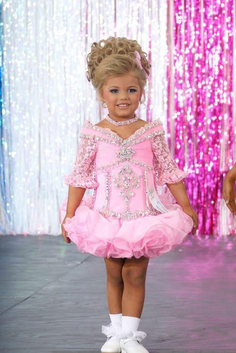 This little girl has autism, and her name is Raychel. The first time she interacted with strangers was at a pageant! Can't pageants do amazing things? :)