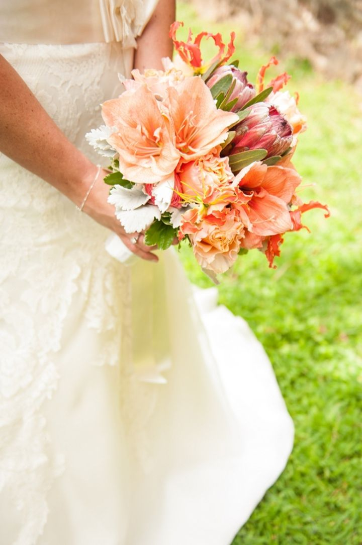 Unique coral bouquet- LOVE! // photo by Jennifer Baumann Photography, http://theeverylastdetail.com/2013/10/11/rustic-coral-and-aqua-wedding/