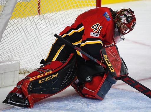 Calgary Flames goalie Mike Smith loses the puck in his pads during the second period of an NHL hockey game against the Ottawa Senators, Friday, Oct. 13, 2017 in Calgary, Alberta. (Jeff McIntosh/The Canadian Press via AP)