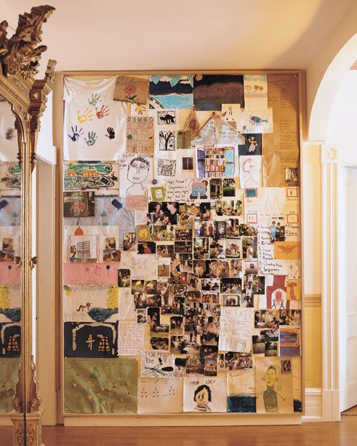 """On the second-floor landing, a floor-to-ceiling bulletin board serves as a changing autobiography of the house. It is overflowing with family art, photos, outlines of original plays, and notes from almost everyone in the clan. The freewheeling spirit of Midwood resounds in a """"to-do"""" list made by Davidson's grandson Jack, at 9, whose plans for one day included """"swimming, running, soccer, climbing trees, twirling, swinging, and cartwheels."""" The previous owners' massive gilded pier glass """"took…"""