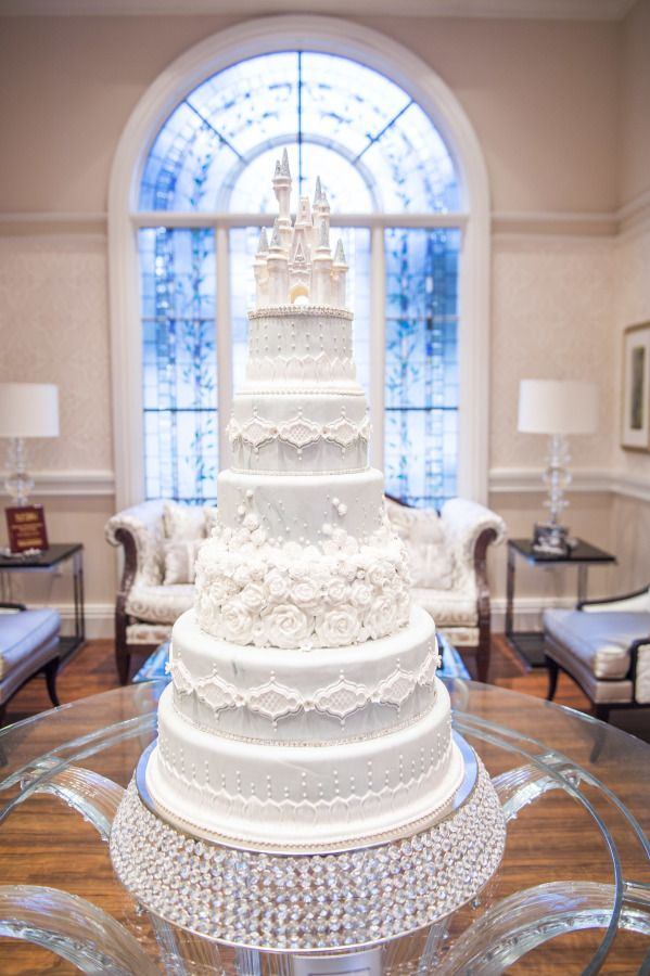 A cake like this is all we need to sway your opinion! Disney's Fairy Tale Weddings & Honeymoons is the place to be! http://www.stylemepretty.com/2017/04/17/5-reasons-a-destination-wedding-honeymoon-with-disney-is-the-absolute-best/ #sponsored